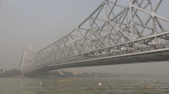 View of the Howrah bridge and Hooghly river in Kolkata, India Stock Footage