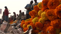 India, flowers for sale at Mulik Ghat market in Kolkata, low angle view - stock footage