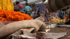 Mulk Ghat Flower Market in Kolkata, low angle view of flowers and vendors Stock Footage