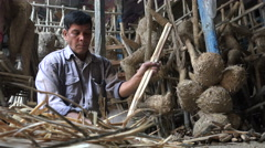Producing straw base for clay effigies in a workshop in Kolkata, India Stock Footage