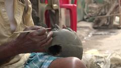 Artist makes clay head for effigy, workshop in Kolkata, religion in India Stock Footage