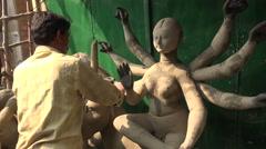 Making clay effigies of Durga Goddess in Kolkata, India - stock footage
