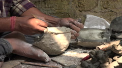 Making the head of a clay effigy for a Hindu festival, in Kolkata, India Stock Footage
