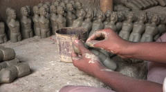 Kumartuli in Kolkata, workshop, artist, clay effigies, craftsman, India religion Stock Footage