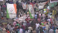 People walk through a busy bazaar in Kolkata, India - stock footage