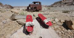 Abandoned Old Truck in Desert Setting with Antique Coil Shoes on Rock Stock Footage
