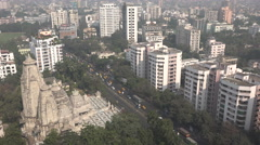 Kolkata skyline, temple complex, office and apartment towers, urban India Stock Footage
