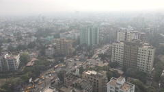Kolkata city skyline, air pollution, busy traffic, smog, urban India Stock Footage