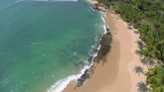Flying over sea waves on tropical beach Stock Footage