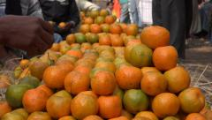 Oranges for sale at a large market in Kolkata, India Stock Footage