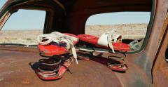 Abandoned Old Truck in Desert Setting with Antique Coil Shoes Tracking Left Stock Footage