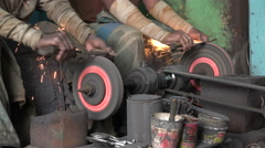 India industry, local economy, workers sharpen knives, closeup, hands Stock Footage