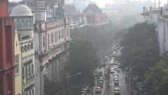 Colonial style buildings in busy commercial street in Kolkata, India Stock Footage