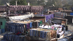 Drying lots of clothing in the famous Dhobi Ghats in Mumbai, India Stock Footage