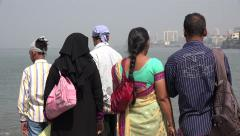 India, Mumbai, a Hindu and Muslim family watch out over the Arabian Sea - stock footage