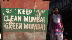 Keep Mumbai clean and green, activism, slogan on waste bin, India - stock footage