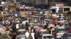India, traffic jam in Mumbai, busy market, congestion, gridlock, commuters Stock Footage