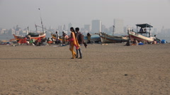 India, Mumbai, poor fishing community contrasts with skyline of modern city - stock footage