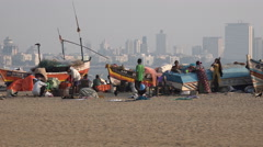 Mumbai city skyline, poor fishing community on the beach Stock Footage