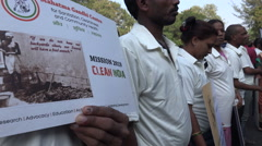 People hold banners for a Cleaner India, during a rally in Mumbai Stock Footage