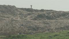 People search for items at garbage dump in Mumbai, India Stock Footage