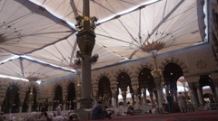 Pilgrims pray and reading Koran inside Nabawi mosque Stock Footage