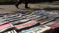 Newspapers for sale at a roadside stall in Mumbai, India. Stock Footage