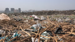 Deonar dumping ground in Mumbai, the largest garbage dump in India, low angle Stock Footage