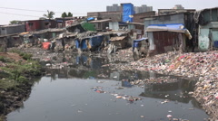 India poverty, Mumbai slum housing, developing country, pollution Stock Footage
