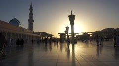 Pilgrims walking at outside of Nabawi Mosque at Medina, Saudi Arabia - stock footage
