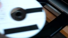 CD or DVD disk - optical drive - television - removing DVD from the drive Stock Footage