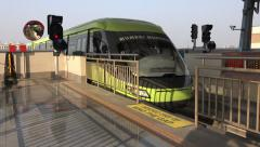 A new monorail train arrives at a station in Mumbai, India Stock Footage