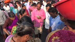 Women trading and bargaining at a busy fish market in Mumbai, India Stock Footage