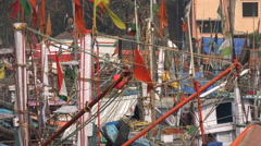 Colorful fishing boats in a port in Mumbai, India Stock Footage