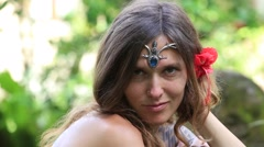 Portrait beautiful hippie girl in nature, close up - stock footage
