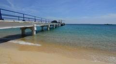 Clean beach and jetty platform in Tioman Island Stock Footage