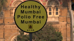 Mumbai India, eradicate polio disease, sign, health, Victoria Terminus Stock Footage