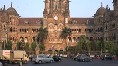 Traffic in front of Victoria Terminus, Mumbai's main railway station Stock Footage