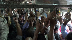 Mumbai commuter train inside, crowded, passengers, busy, transport, India Stock Footage