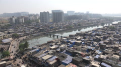 Mumbai, Bandra slums and new financial and business center, contrast Stock Footage