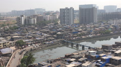Mumbai India, slum housing and business financial district skyline Stock Footage