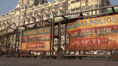 Taj Mahal Palace Hotel in Mumbai, police barriers, security concerns Stock Footage