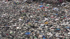India pollution, plastic bags and other waste dumped in a river Stock Footage