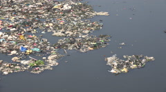 Mumbai India, garbage floating in a polluted river, urban scene Stock Footage