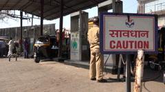India, Mumbai, rickshaw drivers fill their tanks at a CNG petrol station Stock Footage