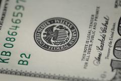 Macro photo of federal reserve system symbol on hundred dollar bill Stock Photos
