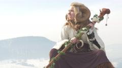 Female Druid sitting on mountain - stock footage