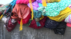 Dripping wet saris that have just been cleaned, Dhobi ghats in Mumbai Stock Footage