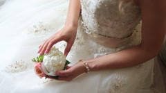 Bride holding a peony Stock Footage