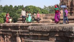 Tourists visit the Konark Sun Temple, warning sign, please take care - stock footage